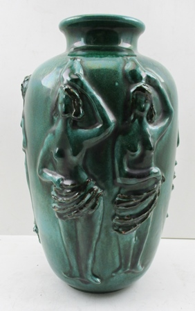 A 20TH CENTURY ITALIAN MODERNIST POTTERY VASE, moulded with standing figures in the round, green glazed, 33cm high