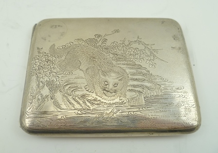 A CHINESE WHITE METAL CIGARETTE CASE, engraved with a cat on a river bank fishing for carp, decorated both sides, gilded interior stamped Wing On Co, (Hong Kong c.1920), 120g