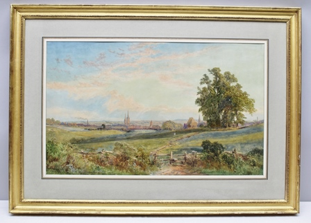 JOHN FAULKENER Coventry the city seen from across fields at sunrise, a stile in the foreground, Watercolour painting, signed and inscribed, 44cm x 72cm, mounted in gilt glazed frame