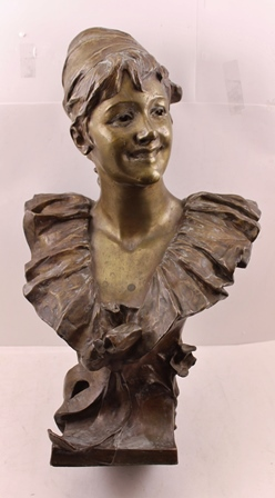 A LATE 19TH CENTURY ART NOUVEAU BRONZE BUST BY BELGIAN SCULPTOR GEORGES VAN DE STRAETEN, depicts a bust of a smiling girl with a ruffled collar, her hair tied up in a scarf, with mask to the base, signed to the back and inscribed Paris, bears sealmark to base for the Societe des Bronzes de Paris, height 60cm
