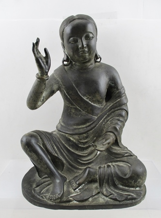 A 19TH CENTURY SINO-TIBETAN BRONZE, seated Arhat, Milarepa, right hand raised (Theravada Buddhism defines Arhat as one who has gained insight and achieved Nirvana, other Buddhist that they are advanced along the path of enlightenment, but not reached Buddhahood), 31cm high