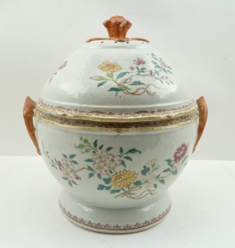 A CHINESE FAMILLE ROSE CIRCULAR PORCELAIN TERRINE WITH COVER QIANLONG (1736-95), painted and gilded with peony and blossom sprays tied with ribbons, orange glazed handles and cover knop, the cover pierced with holes to the top of the dome, 30cm high
