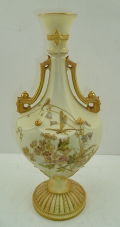 A ROYAL WORCESTER TWIN-HANDLED VASE, pattern no. 1535, having flared rim to neck, geometric handles, ivory ground with gilded and painted blossom decoration to body, raised upon a domed circular foot, bears puce printed factory marks to base, date code 1892 with reg. no. 176647 and 1535, 30cm high