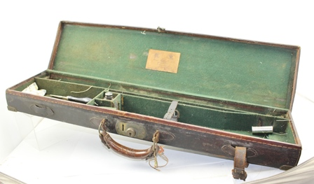 A JAMES PURDEY AND SONS, LONDON LEATHER SINGLE SHOTGUN CASE, bears label inside lid, brass reinforced, green baize lined, 82cm wide (contains various shooting accessories)