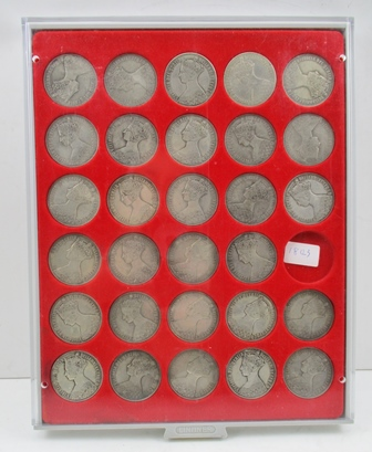 A COIN COLLECTORS TRAY OF TWENTY NINE VICTORIAN CROWNS, all of the early Gothic type