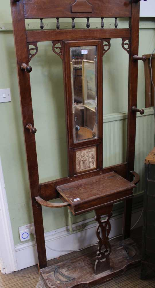 AN EARLY 20TH CENTURY OAK HALL STAND with cen