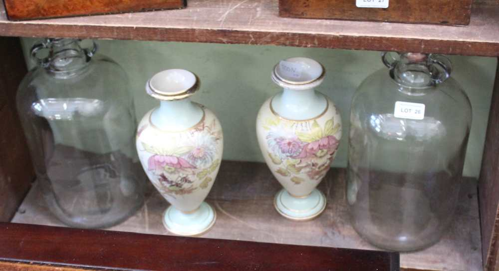 TWO GLASS DEMI JOHNS together with a pair of