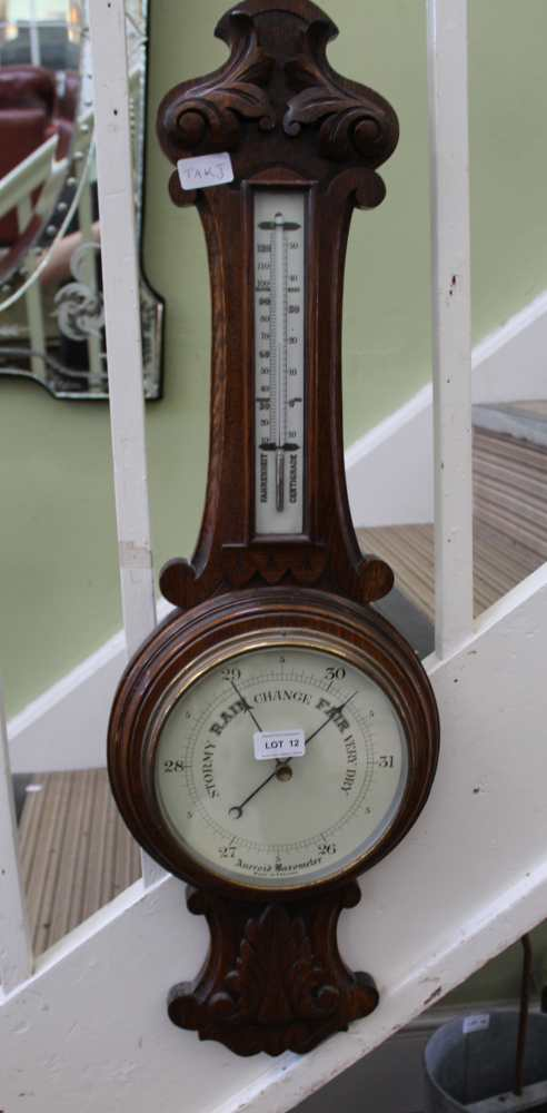 A 19TH CENTURY OAK BACKED BAROMETER THERMOMET