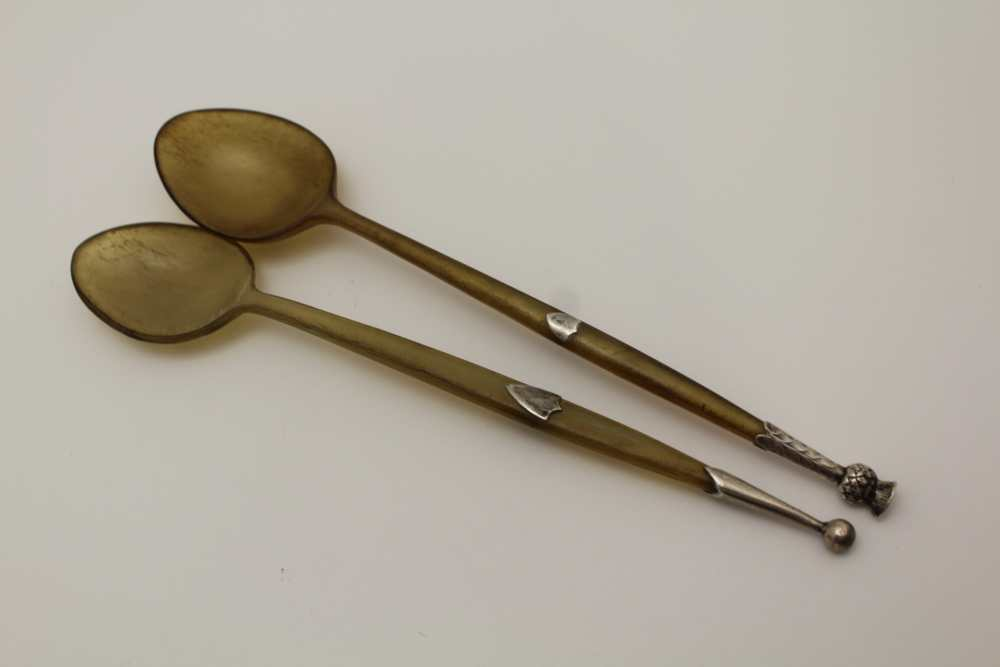 TWO LATE 19TH CENTURY HORN SPOONS, white meta