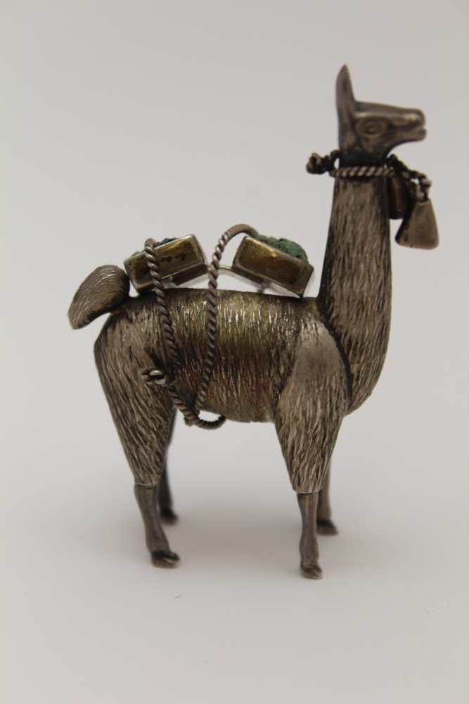 A WHITE METAL MODEL OF A LLAMA/ALPACA, With t