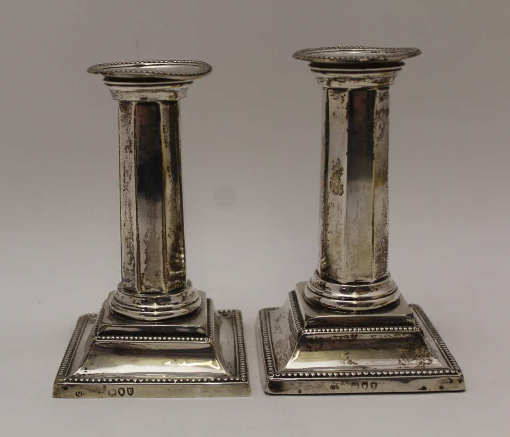 CHARLES BOYTON II A PAIR OF SILVER CANDLESTIC