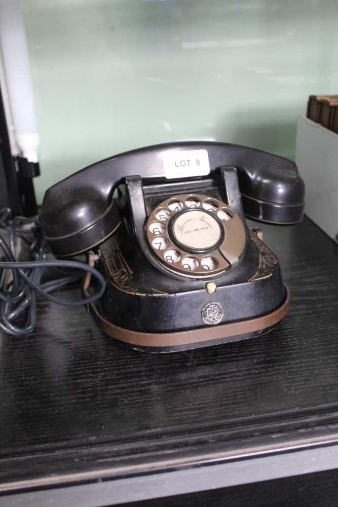 A VINTAGE METAL DIAL TELEPHONE by Bell Indust