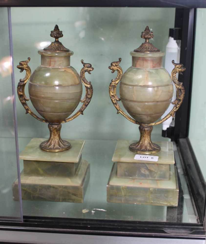 A PAIR OF METAL MOUNTED ONYX URNS