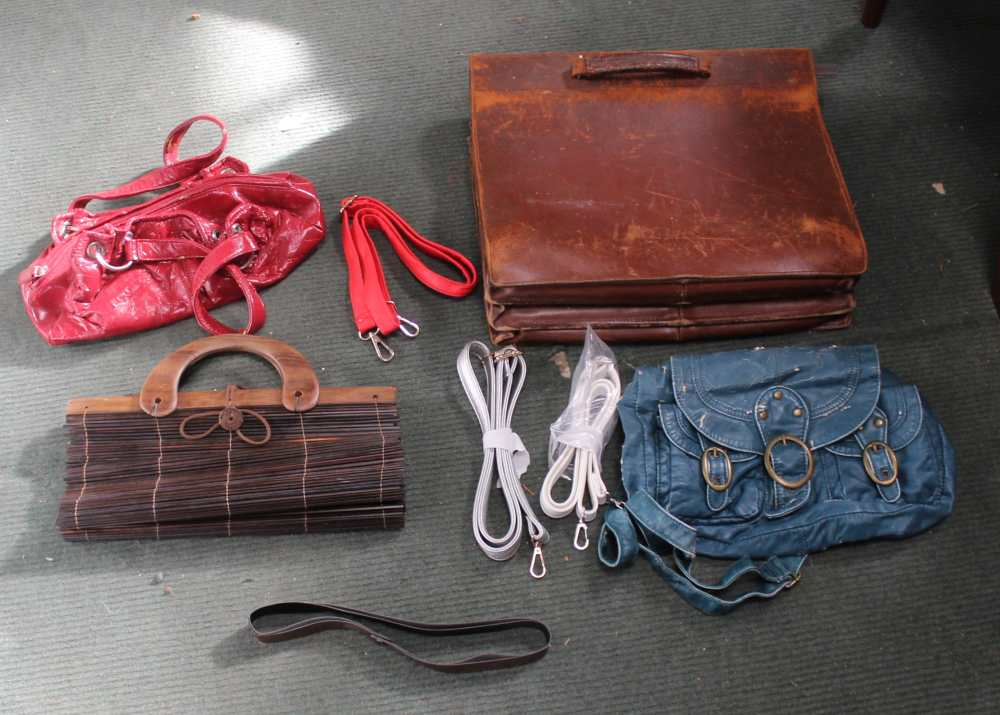 A TANNED PIGSKIN BRIEFCASE together with sund