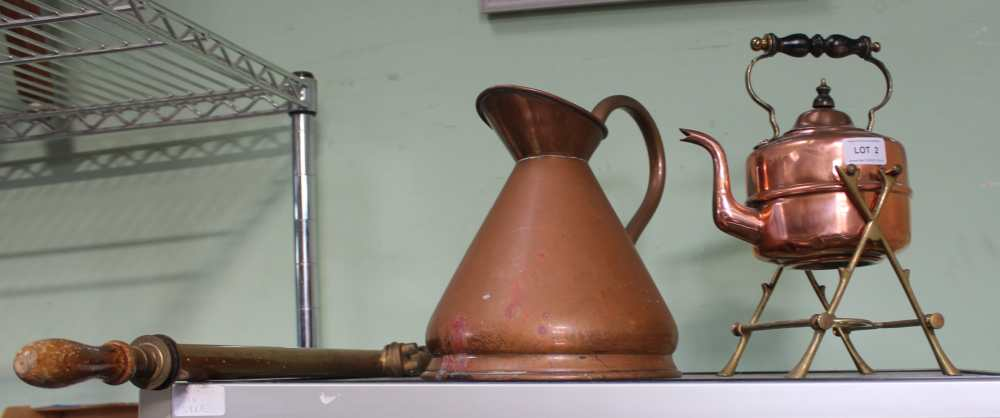 A COPPER KETTLE on brass burner stand