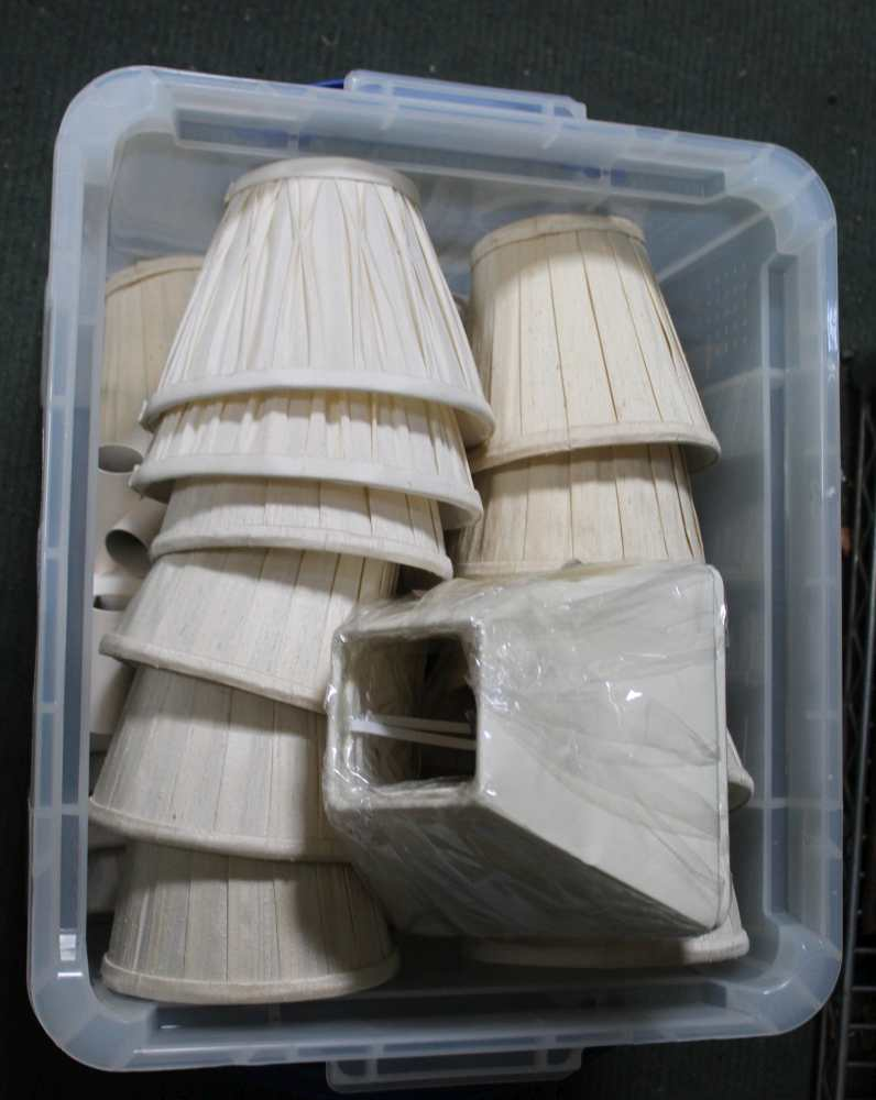 A CRATE CONTAINING A SELECTION OF LAMP SHADES