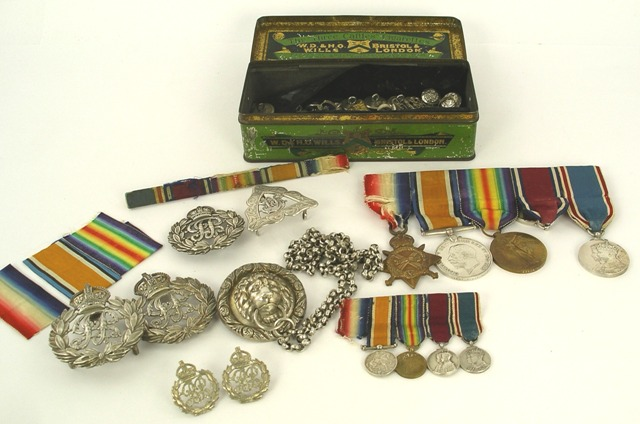 A SET OF GREAT WAR PERIOD MEDALS FOR 2ND LIEUTENANT ARTHUR EDWARD FRANCIS WOOD 14th Lancers; comprising Pip, Squeak and Wilfred, George V and George VI Long Service Medals, set of miniatures same (one missing ribbons and bars), and a collection of six Regimental silver badges, various buttons, buckle etc.