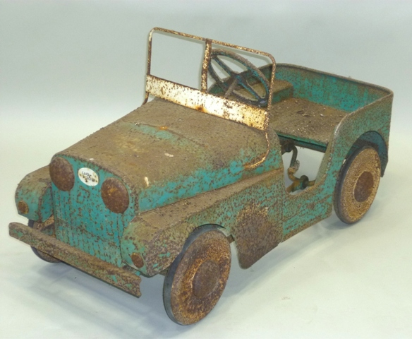 AN EARLY PAINTED METAL PEDAL CAR LANDROVER SERIES I in original paintwork