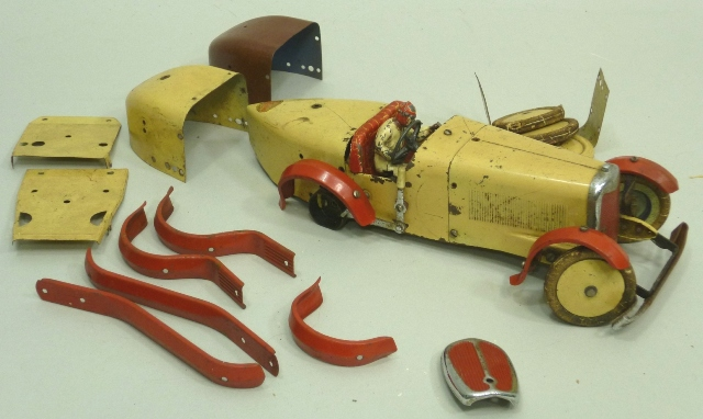 A 1930'S MECCANO CLOCKWORK MODEL OF A BUGATTI RACING CAR in cream livery, with red running boards and trim