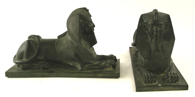 TWO 20TH CENTURY CAST AND PATINATED BRONZE MODELS OF A SPHINX lying on a rectangular plinth, 14cm x 23cm