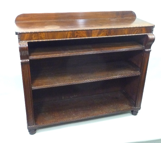 A PRINCIPALLY EARLY VICTORIAN MAHOGANY BOOKCASE, having plank figured top with upstand, beaded front, two shelves and fluted uprights, raised on four later ring turned feet, 94cm x 110cm