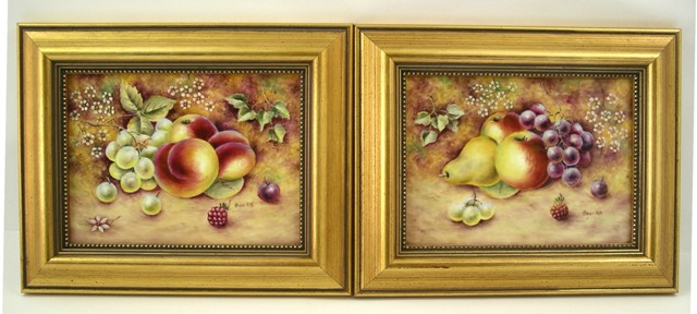 BRYAN COX A PAIR OF PORCELAIN PLAQUES depicting peaches, grapes, plums, apples, pear, flora and foliage, signed, 12cm x 16.5cm, in gilt moulded frames