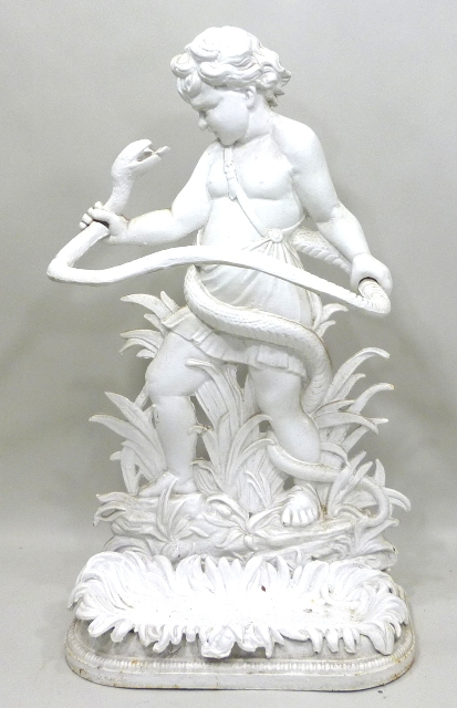 A PROBABLY VICTORIAN WHITE PAINTED CAST IRON UMBRELLA STAND fashioned as a boy with a snake standing on a foliate base with tray, 82cm x 46cm