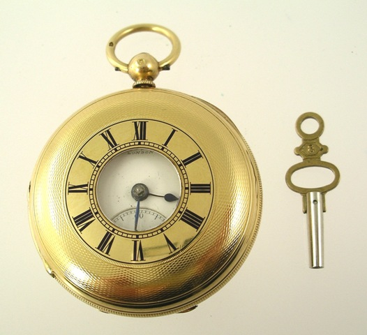 CHAS FREDERICK MAGRATH AN 18CT GOLD GENTLEMAN'S DEMI-HUNTER STYLE POCKET WATCH having engine turned decorated case, unusual opening with no internal glass or bezel, possibly originally a braille watch, now having Roman calibrated enamel dial, fuseemechanism with Massey lever escapement and modern key, London, 1873