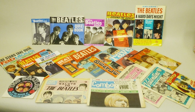 A SELECTION OF BEATLES MEMORABILIA to include a card, Beatles Scrap Book (large unused), Beatles Song Book (Fabulous Magazine), Beatles on Broadway (large illustrated), Beatles at Carnegie Hall, Beatles in America, Beatles Film Magazine (Pop Pics Special), Pictorial Souvenir Book of A Hard Day's Night, Beatles Monthly no. 22 (May 1965), no. 19 (February 1965) and no. 16 (November 1964), Beatles Around the World, Beatles Quiz Book (Colting) 1964, Liverpool Echo Salute The Beatles, and a small black and white card photo (free with a magazine)