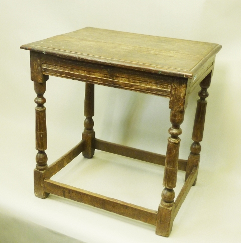A PART 19TH CENTURY OAK SIDE TABLE, having rectangular plank top with moulded edge, raised on turned and blocked legs united by box stretchers, 69cm x 67cm