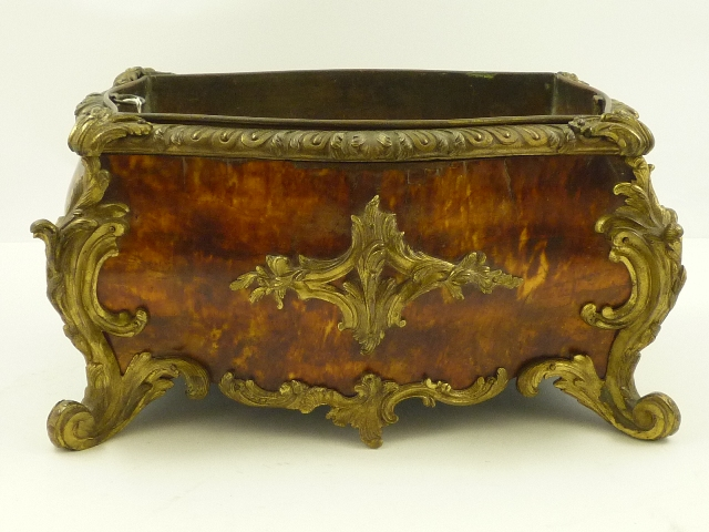 A 19TH CENTURY ENGLISH LOUIS XIV STYLE ORMOLU MOUNTED TORTOISESHELL PLANT TROUGH, having gadroon and scroll border and bombe' shaped body with copper liner, 19cm x 36cm extreme