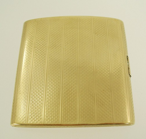 A. J. ZIMMERMANN & SONS A 9CT GOLD CIGARETTE CASE, having engine turned front and back and polished interior, monogramed interior, Birmingham 1926