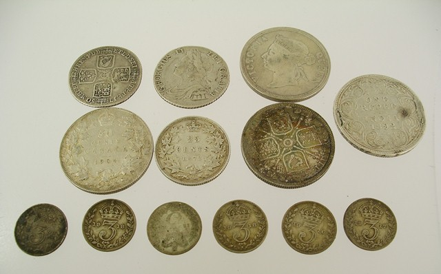 A SELECTION OF 18TH AND 19TH CENTURY BRITISH SILVER COINS comprising two George III Shillings, Victorian Florin, one Victorian Shilling, three Empire Coins and six 3ds, 75g