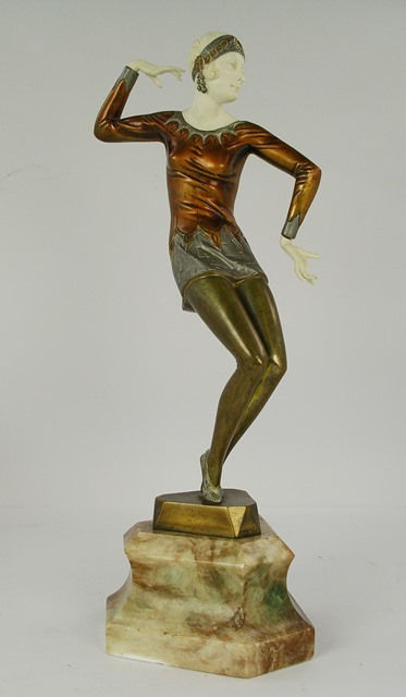 FERDINAND PREISS Dancing the Charleston, a young Art Deco woman, her slinky tunic in bronzed and silvered finish, on an integral triform base and marble plinth, 38cm high