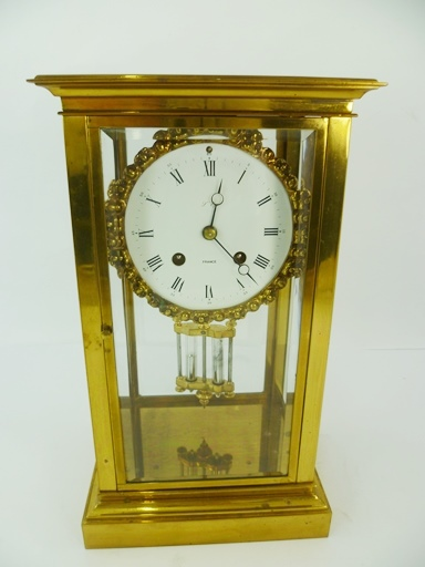 LEPEE - FRANCE A FRENCH 20TH CENTURY GILT BRASS FOUR-GLASS REGULATOR, having Japy type drum mechanism with rack bell strike and mercurial pendulum, faced by a Roman calibrated dial, 30cm high x 15cm wide