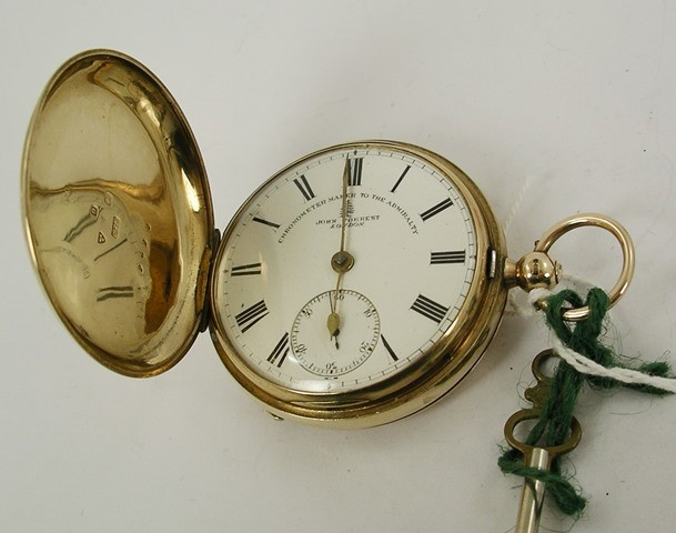 JOHN FORREST - LONDON (Chronometer Maker to the Admiralty) A 9CT GOLD HUNTER CASED GENTLEMANS ENGLISH POCKET WATCH, having English lever fusee mechanism with jewelled train bi-metallic balance, plain case faced with Roman calibrated dial, Chester 1910