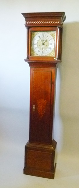 W. PARKES, WOLVERHAMPTON A LATE 18TH/EARLY 19TH CENTURY OAK 8-DAY LONG CASE CLOCK the hood with moulded pediment, fretted frieze and flank pilasters, four pillar mechanism with rack bell strike faced by a 12 brass dial with cast spandrels and silvered chapter, plain trunk with box base, on plinth, 2.16m high