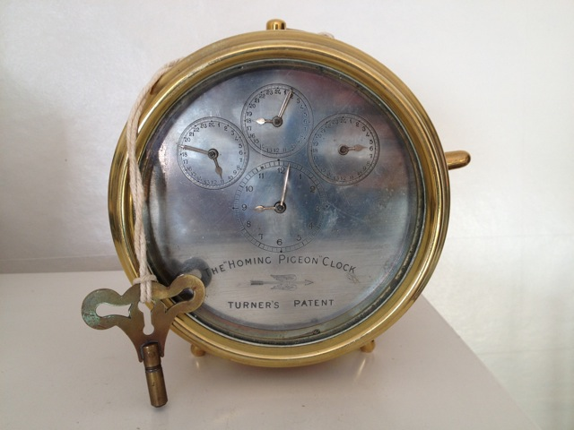 AN EARLY 20TH CENTURY BRASS CASED HOMING PIGEON CLOCK, Turners Patent, having silvered dial with four subsidiaries, binnacle style brass case, inscribed Hateley Patent, No. 14307/07, with swing brass carry handle