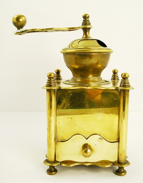 A LATE 19TH/EARLY 20TH CENTURY CONTINENTAL, POSSIBLY FRENCH, COFFEE GRINDER of commercial proportions, having fretted crank handle top on a cube shape body with four finials and drawer, 29cm high