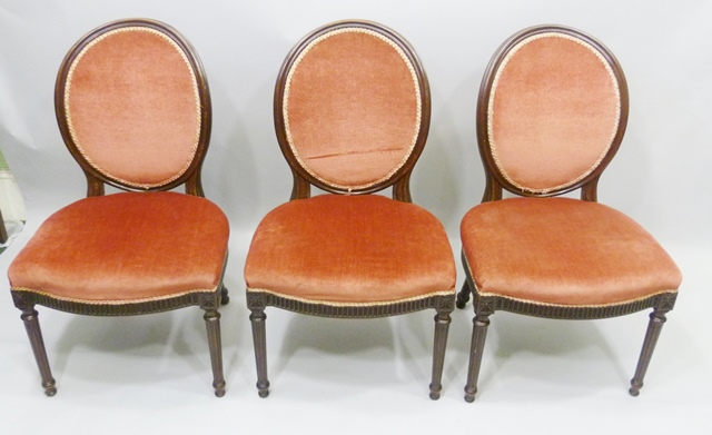 A SET OF TEN MAHOGANY PARLOUR ARM CHAIRS, each having a moulded show wood frame with salmon pink dralon oval pad and overstuffed seat, raised on turned and fluted forelegs, comprising two carvers and eight singles