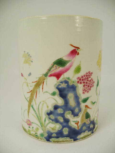 AN EARLY 20TH CENTURY LATE CHING DYNASTY PORCELAIN BRUSH POT painted in polychrome with peacock, flora and foliage, 15.5cm high