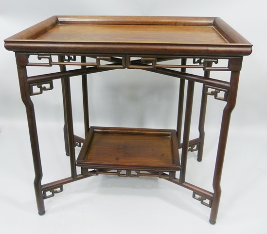 AN EARLY 20TH CENTURY CHINESE HARDWOOD COLLAPSIBLE TABLE having rectangular trap top, fretted gallery and x-shape support with undertier, 70cm x 75cm