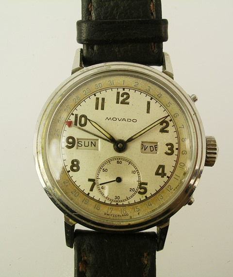 A GENTLEMANS 1940S/50S STEEL CASED MOVADO TRIPLE CALENDAR WRIST WATCH having silvered Arabic enumerated dial with day date and seconds subsidiaries, on leather strap