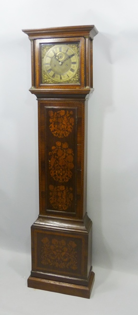 GARRETT - LONDON (possibly Charles or John) A LATE 17TH/EARLY 18TH CENTURY LONGCASE CLOCK, having period 11 dial with cast spandrels, subsidiary seconds,  8-day mechanism with anchor escapement, in a later case richly embellished with marquetry, having moulded pediment, flank pilasters with brass capitals and a waist panel door, on plinth with moulded base, 1.99m