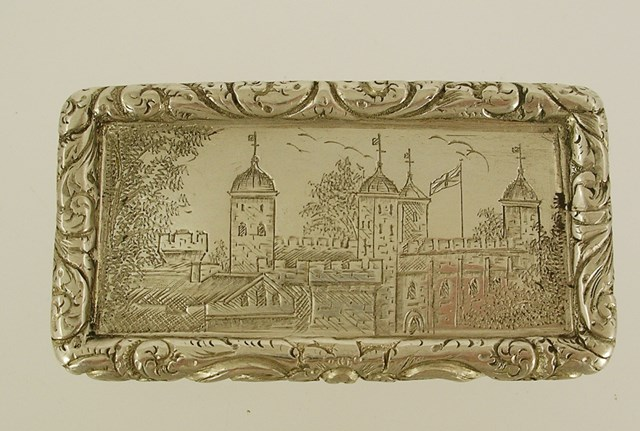 JOHN BETTERIDGE A GEORGE IV RECTANGULAR SILVER SNUFF BOX, the lid tooled with a view of the Tower of London, and applied wire foliate surround, the body engine turned finished, the interior scoured, no finish, Birmingham 1824, 19mm x 67mm, 68g.
