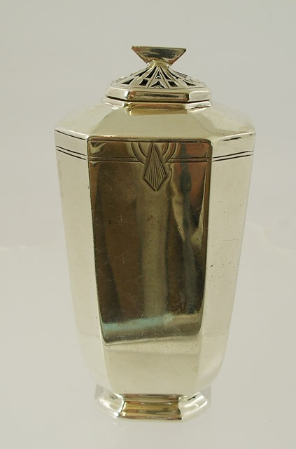 EDWARD VINER AN ART DECO STYLE SILVER SUGAR CASTER having octagonal lid and sifting filter, upon a square tapered and canted body, with engraved geometric motifs and octagonal foot