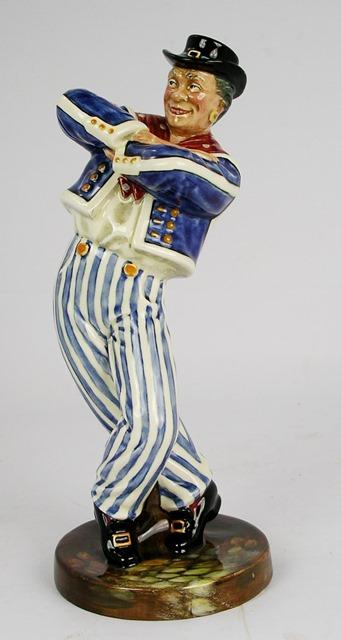 A ROYAL DOULTON EARTHENWARE FIGURE The Hornpipe, a sailor in striped pantaloons, HN2161