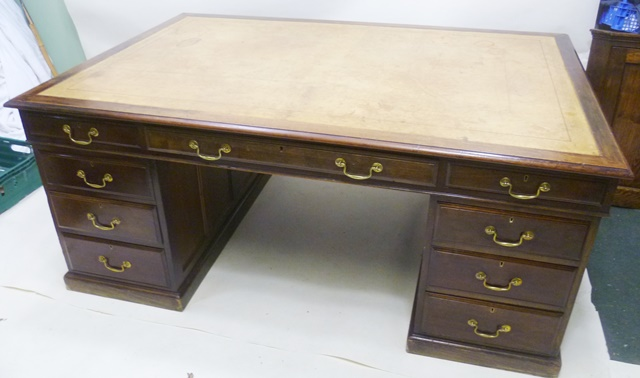 A VICTORIAN MAHOGANY PARTNERS DESK having later tooled tan leather skiver with moulded edge, raised on twin pedestal supports, each with recessed panelled sides, three drawers, on plinth, 78cm high x 1.85m wide