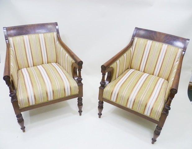 A PAIR OF 19TH CENTURY NAPOLEON II FRENCH FAUTEUILS, each having figured feathered mahogany crest rail, red and golden yellow stripe upholstery, twin swept arms with ringed turned supports, overstuffed seat, raised on turned and carved forelegs
