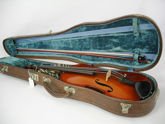 A FULL SIZE VIOLIN labelled M. Couturieux internally, having red/brown varnish, 14.5 back including button, with bow and brown case